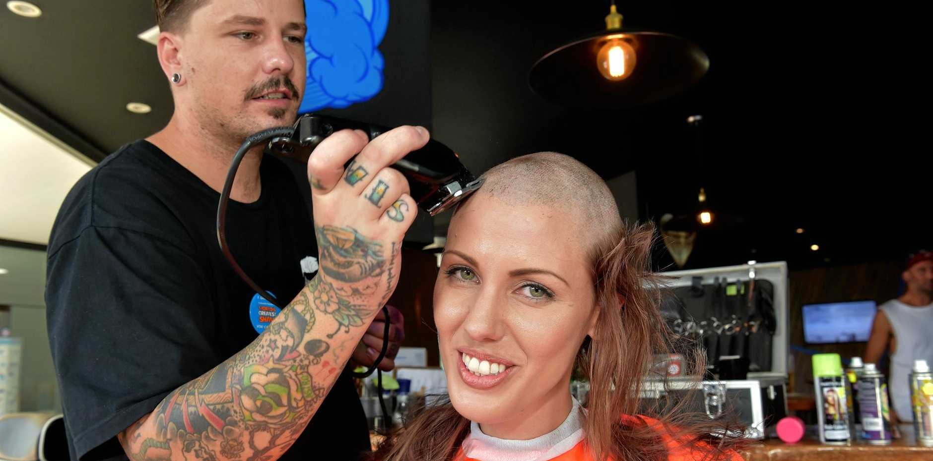 CHOP CHOP: Laura Hetherington shaves her hair, raising money the Leukaemia Foundation, at Sneaky Baron, which held a Shave for a Cure event in Maroochydore.