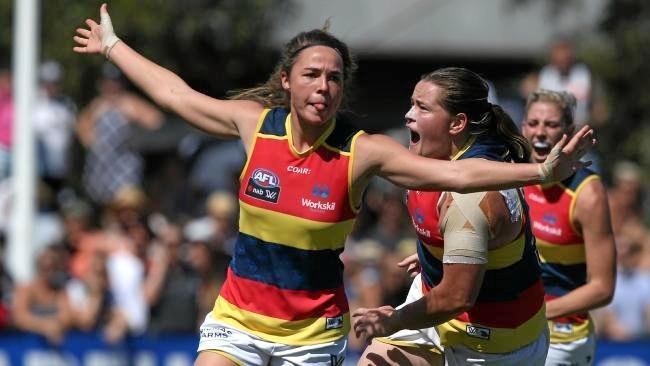 Jenna McCormick celebrates a goal for Adelaide.