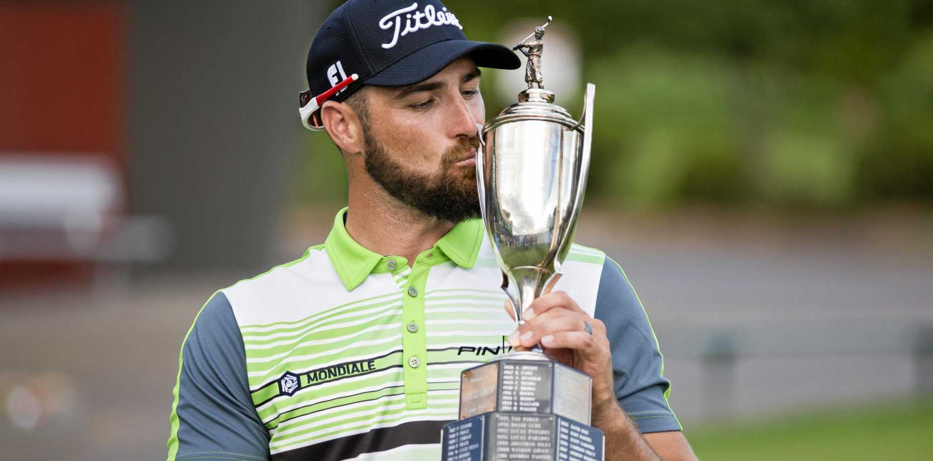 Daniel Pearce celebrates his victory today in the Coca-Cola Queensland PGA Championship final round at City Golf club.