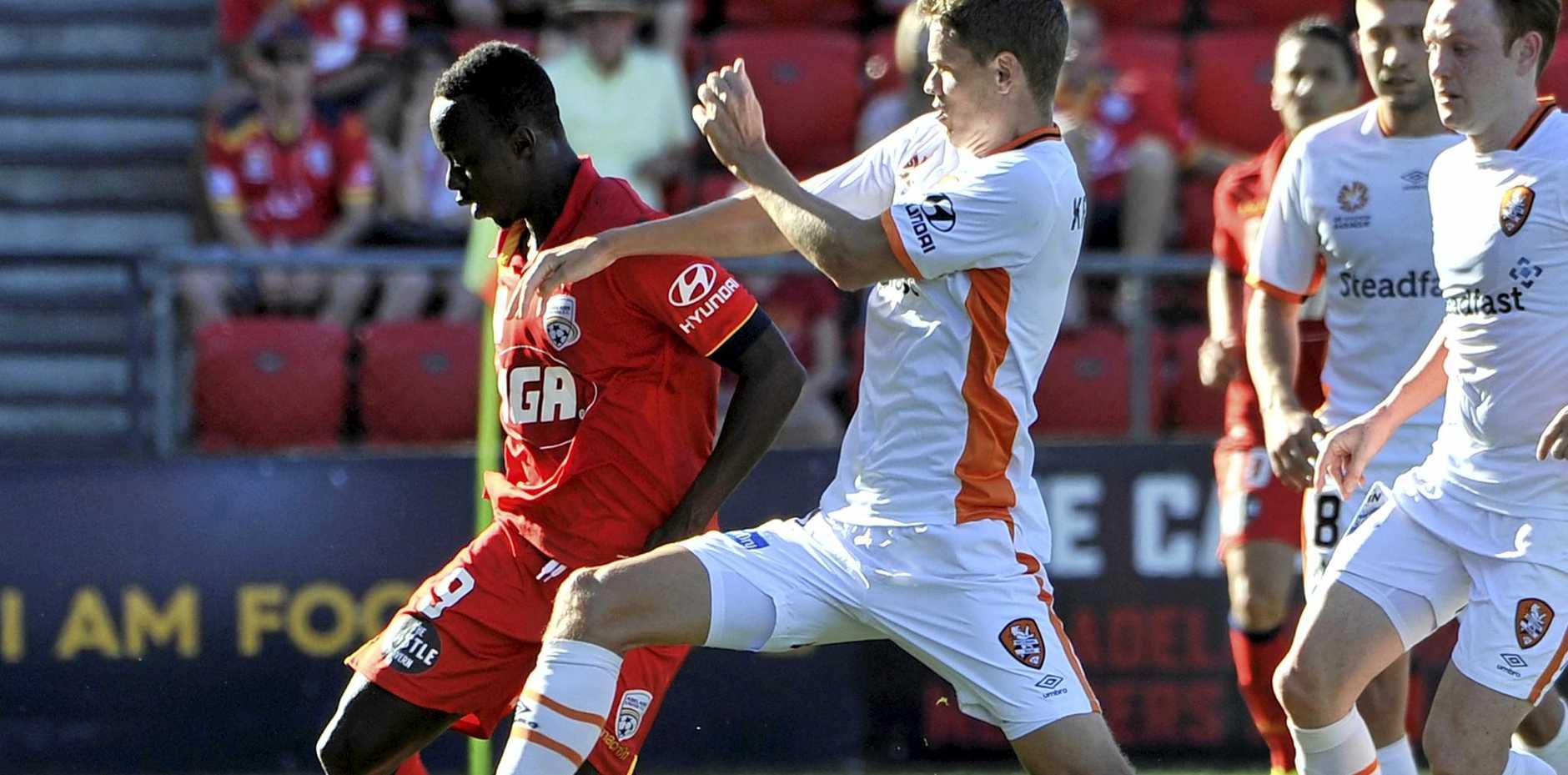 Papa Babacar Diawara (left) scored for Adelaide against the Roar.