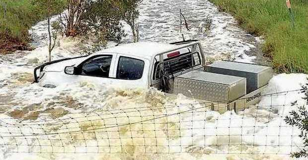 A ute sinks in flood waters over the weekend near Grafton.