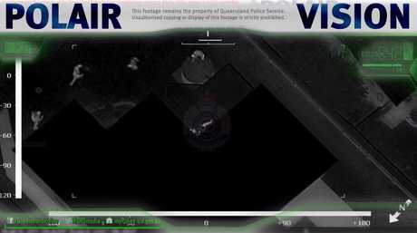 POLAIR vision shows a suspect on the roof while police approach.