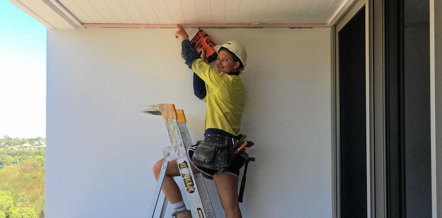 NO DIFFERENT: Fourth year apprentice carpenter Amelia Robertson, on the job with Kane Constructions at Noosa.