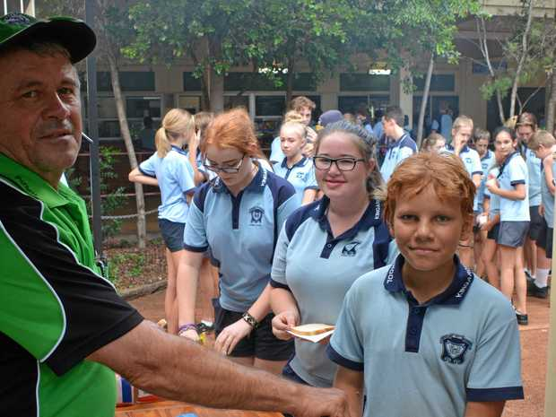 MESSAGE OUT: Ulysses member Peter McLennan serves up a sausage on Anti-Bullying Day to Nick Hume.