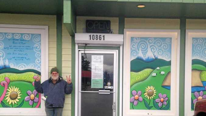ABOVE: Michael Balderstone in front of the pot shop.
