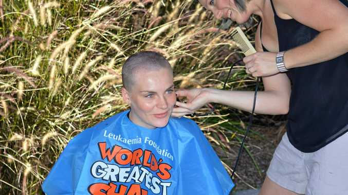 BRAVE: Ellie Winzar undertakes the World's Greatest Shave for Team J and J at the Hatton Vale Golf Club.