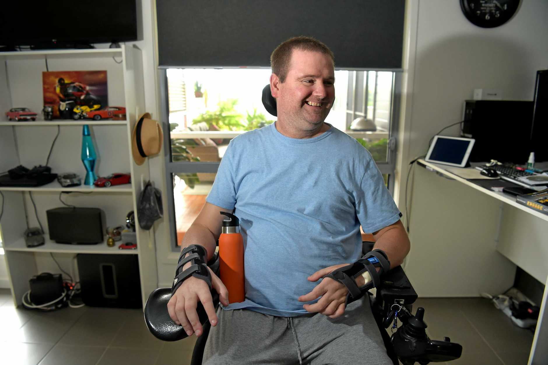 HAPPIER times for Jarrad Quinn who is regaining movement in his body through exercise after being left a quadriplegic by a dirt bike accident. He is raising money for a standing wheelchair.