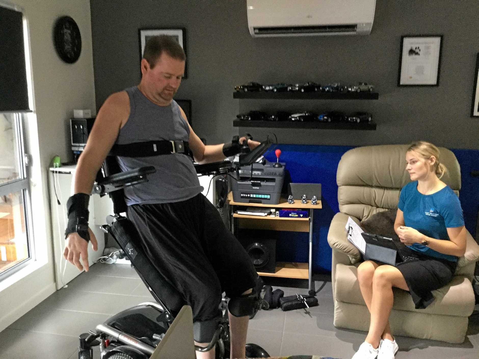 JARRAD Quinn tries out the LEVO standing wheelchair which he hopes to be able to buy if he can raise sufficient funds.