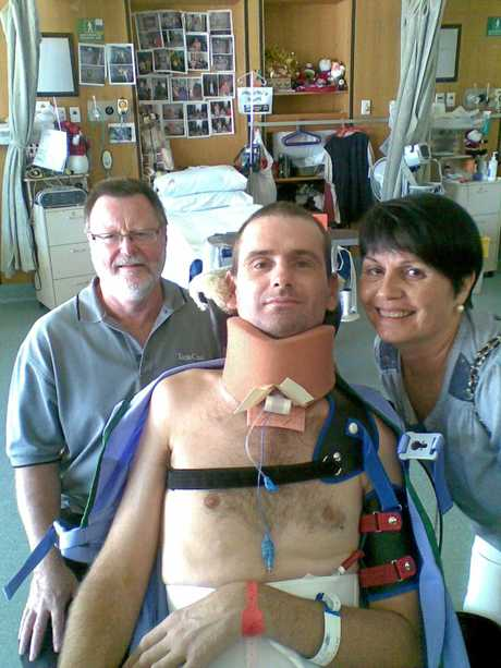 Jarrad Quinn with his parents Derek Laird and Judy recovering in hospital after his horrific injury.
