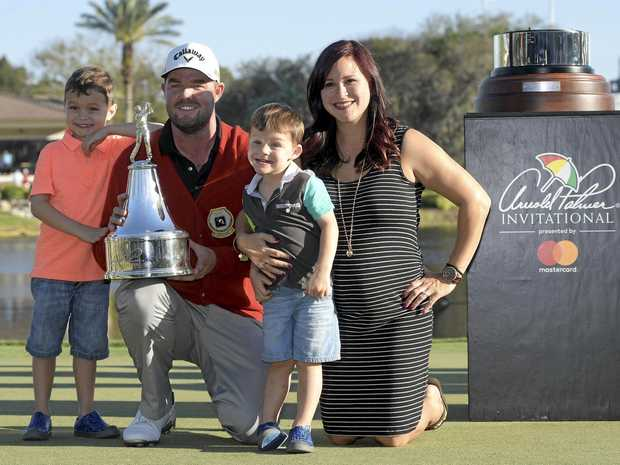 Marc Leishman, of Australia, poses with his family, while holding the championship trophy after winning the Arnold Palmer Invitational golf tournament in Orlando, Fla., Sunday, March 19, 2017. With Leishman are sons, Harvey, 5, left, and Oliver, 3, and wife, Audrey. (AP Photo/Phelan M. Ebenhack)
