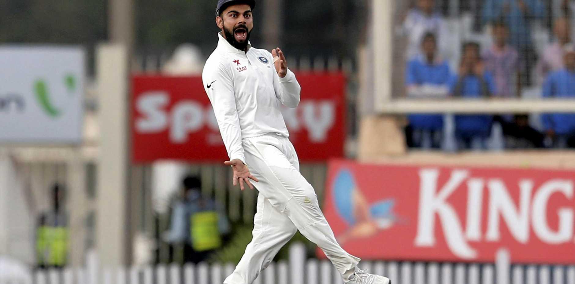 India's captain Virat Kohli celebrates the dismissal of David Warner on day four in Ranchi.