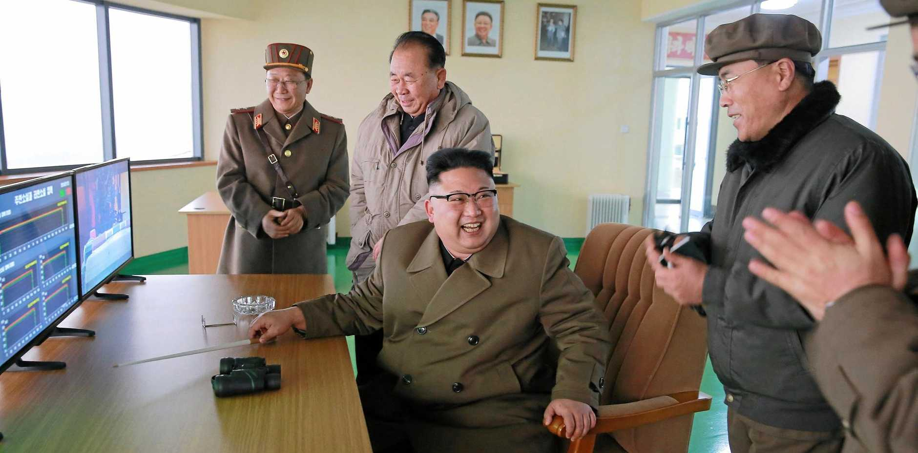 North Korean leader Kim Jong-un (centre) watches the ground jet test of a high-thrust engine on screens at an undisclosed location in North Korea, on Saturday.