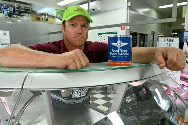 Shane Simpson from Tender Sprouted Meats is disappointed that someone would steal the Royal Flying Doctor Services donation tin from the shops front counter.