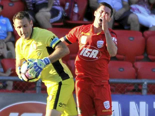 Michael Theo of Brisbane Roar and Dylan McGowan of United clash at Coopers Stadium