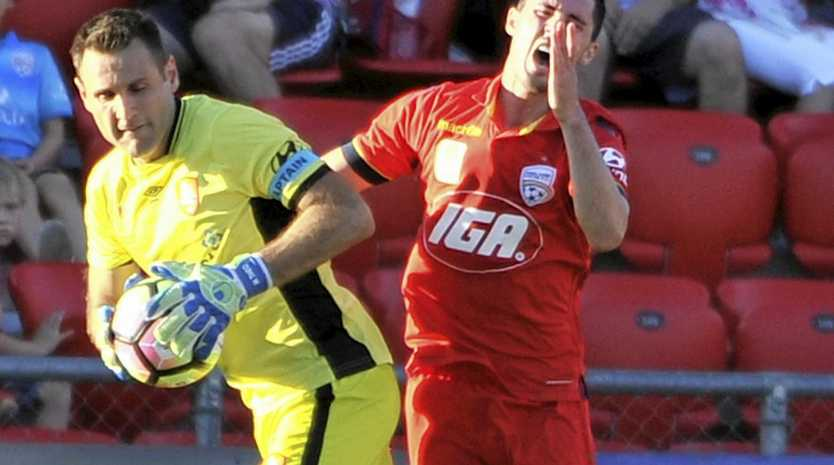 Michael Theo of Brisbane Roar and Dylan McGowan of United clash on Sunday.