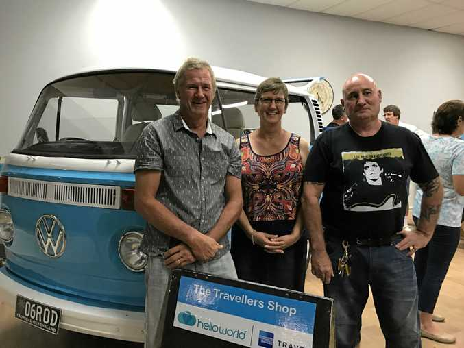 RODNEY RULES: Among the crowd at the Travellers Shop's grand re-opening is Rod Fraser (left), who restored Rodney the Kombi to his former glory, Rod's wife Liu and Rodney's previous owner Simon Kahn.