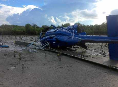 The scene of a helicopter crash on Curtis Island, where two men were lucky to survive after they were found more than a day after the crash.