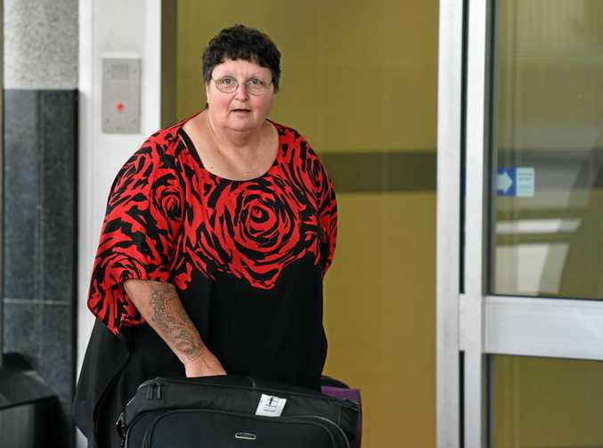 Wendy Baulch when she was released from a Brisbane police station with her suitcases in February, 2015. She had just returned from a cruise she paid for with fraudulently obtained money.