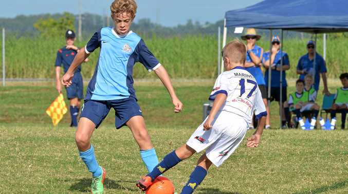 Under 12 Mackay Crusader Jacob Wicks (left) keeps his eye on the ball against Gladstone.