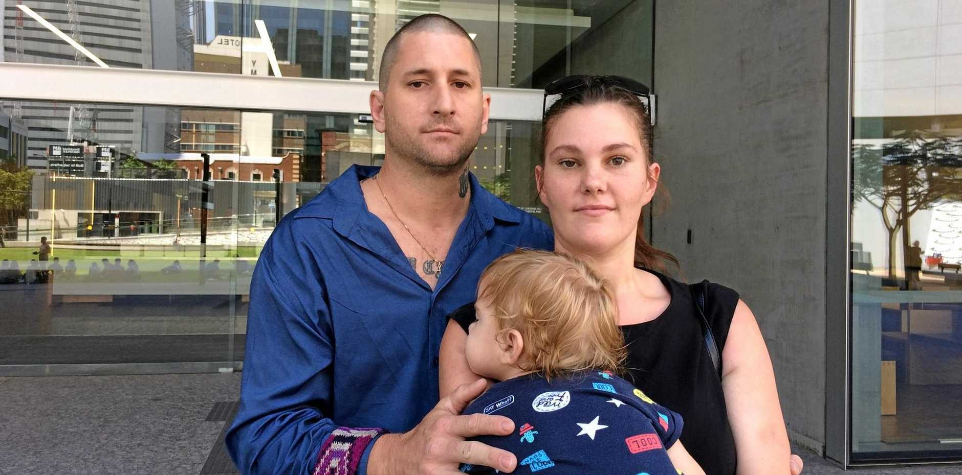 RECOVERED: Gympie father Timothy Udris, who survived a hammer attack in June, 2014, outside Brisbane Supreme Court with his wife Emily.