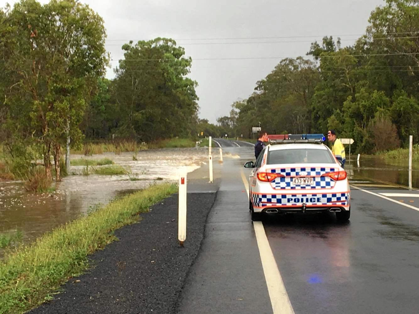 Police have closed a section of Booral Rd due to floodwaters.