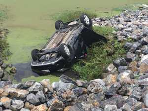 WATCH: Car crushed after flipping off highway into Rocky lagoon