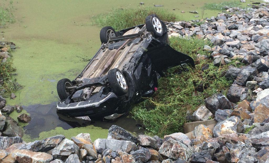 ROLLOVER: Car rolls off bridge into a lagoon.