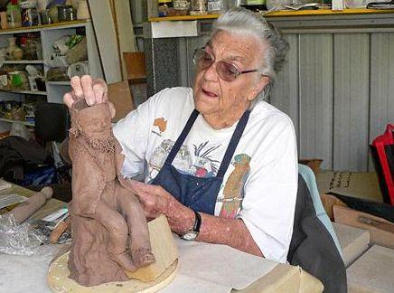Maitlia Potter Audrey Reece sculpts a swagman during a class at Bottlebrush Craft Centre in Maryborough.