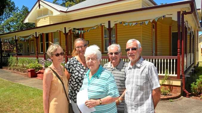 MUSEUM MEMBERS. Alstonville Plateau Historical Society outside the century-old Crawford House.