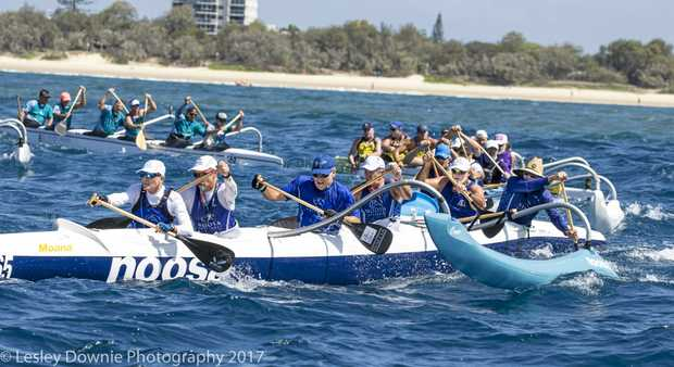 GOING HARD : The Noosa Outriggers in action on the water.
