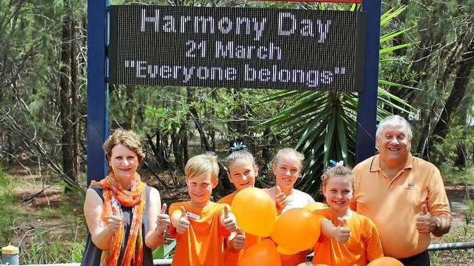 AS ONE: Noosaville State School leaders are joined by Mary McMahon and Bendigo Bank's Wayne Hoens in preparation for Harmony Day.