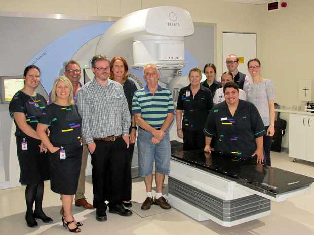 Bargara patient Garry Kane (centre) is one of the many residents grateful to have been able to receive world-class radiation therapy treatment close to home.