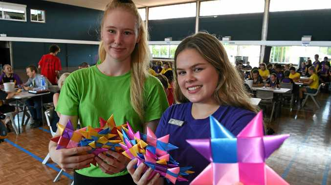 NORTH STARS: Skie Cronin and Amber Tobin with stars produced by the North Bundaberg State School students