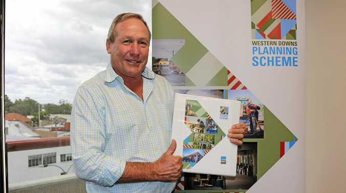 DONE DEAL: WDRC Mayor Paul McVeigh with the new Western Downs Planning Scheme.