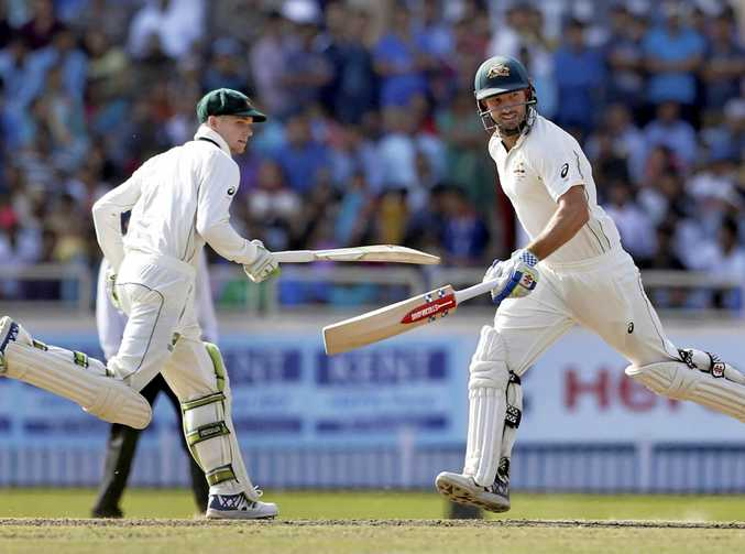 Shaun Marsh, right, and Peter Handscomb run between the wickets during in their match-saving parthnership.