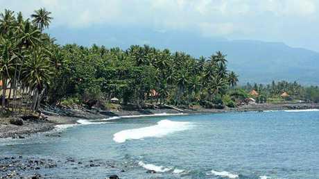 The black sands of a beach in Jasri, Bali.
