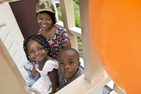 CELEBRATON: Penny Mwibusa enjoys Harmony Day celebrations with her children Grace and David Mwibusa at St Luke's Hall.