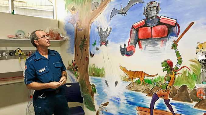 Patient transport officer Shane Foley created the mural for children visiting the emergency department at Bundaberg Hospital.