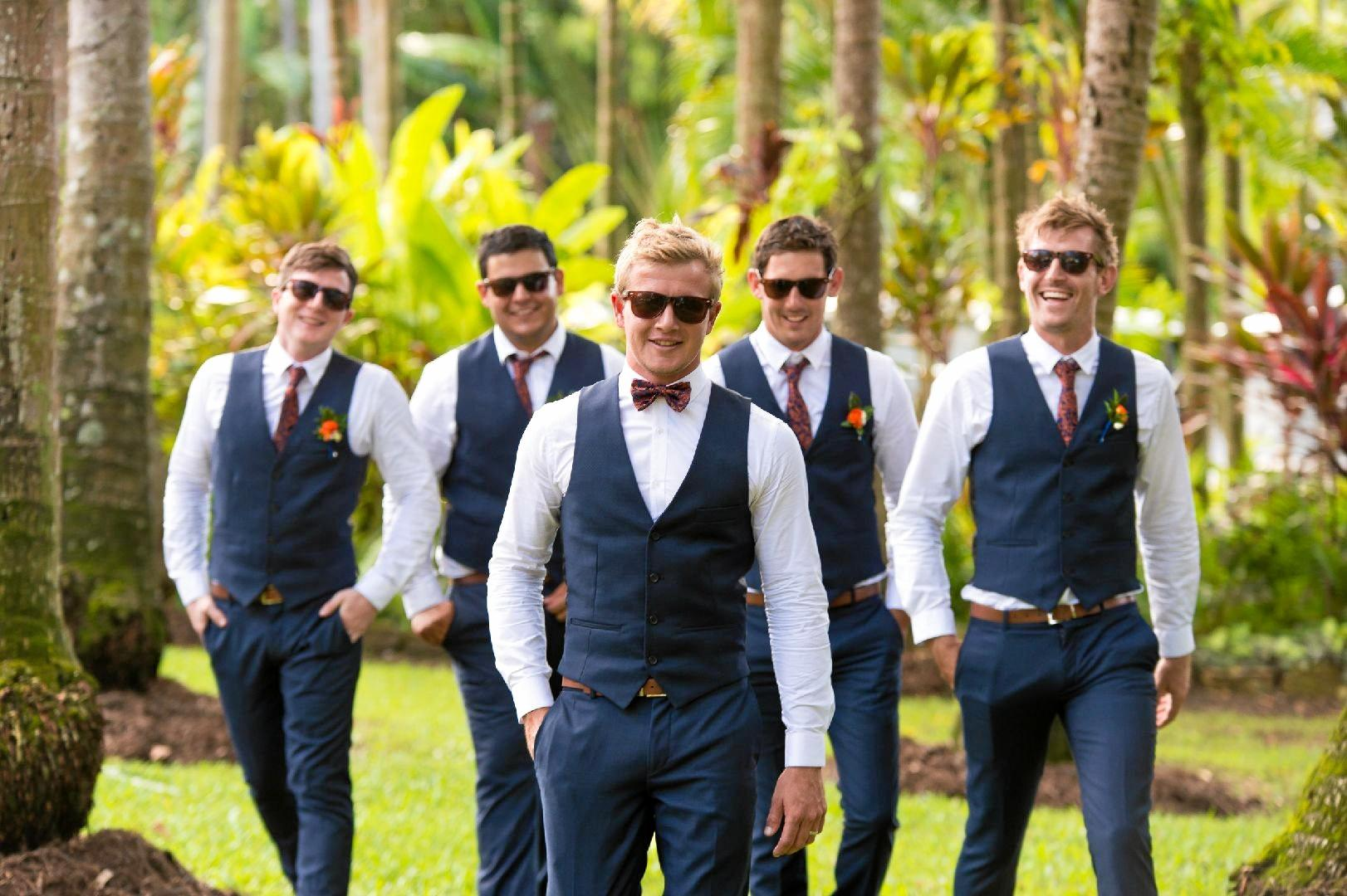 The groomsmen wore black and white tuxes with Ray Bans to top off the look.