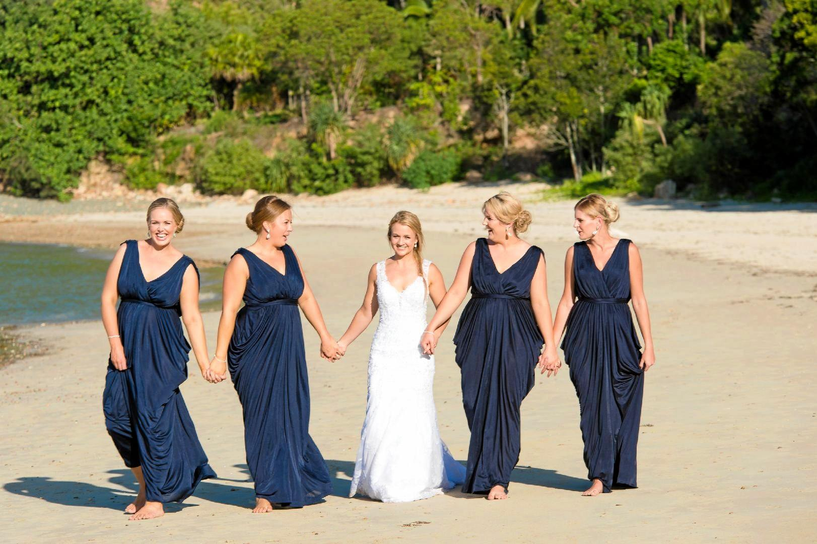 Melissa's bridal party donned deep navy dresses for the special day.