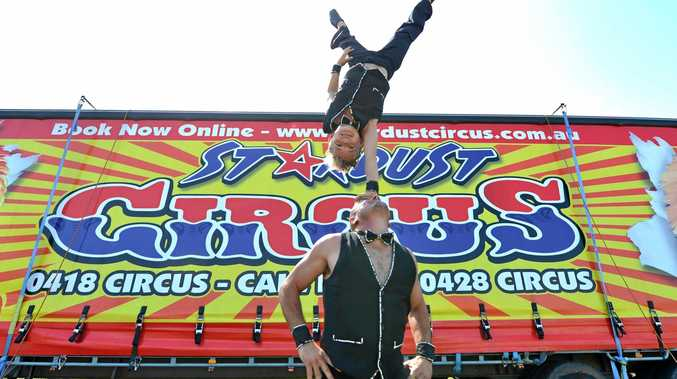 Gene West  and his nephew Cassius West practice their acrobatic routine as Stardust Circus sets up at the showgrounds.Photo Lee Constable / Daily Mercury