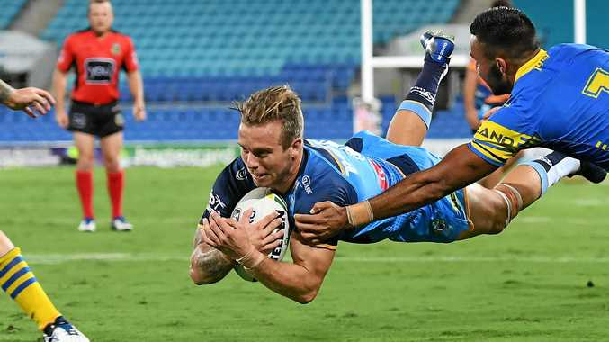 Kane Elgey of the Gold Coast Titans scores a try against the Parramatta Eels.