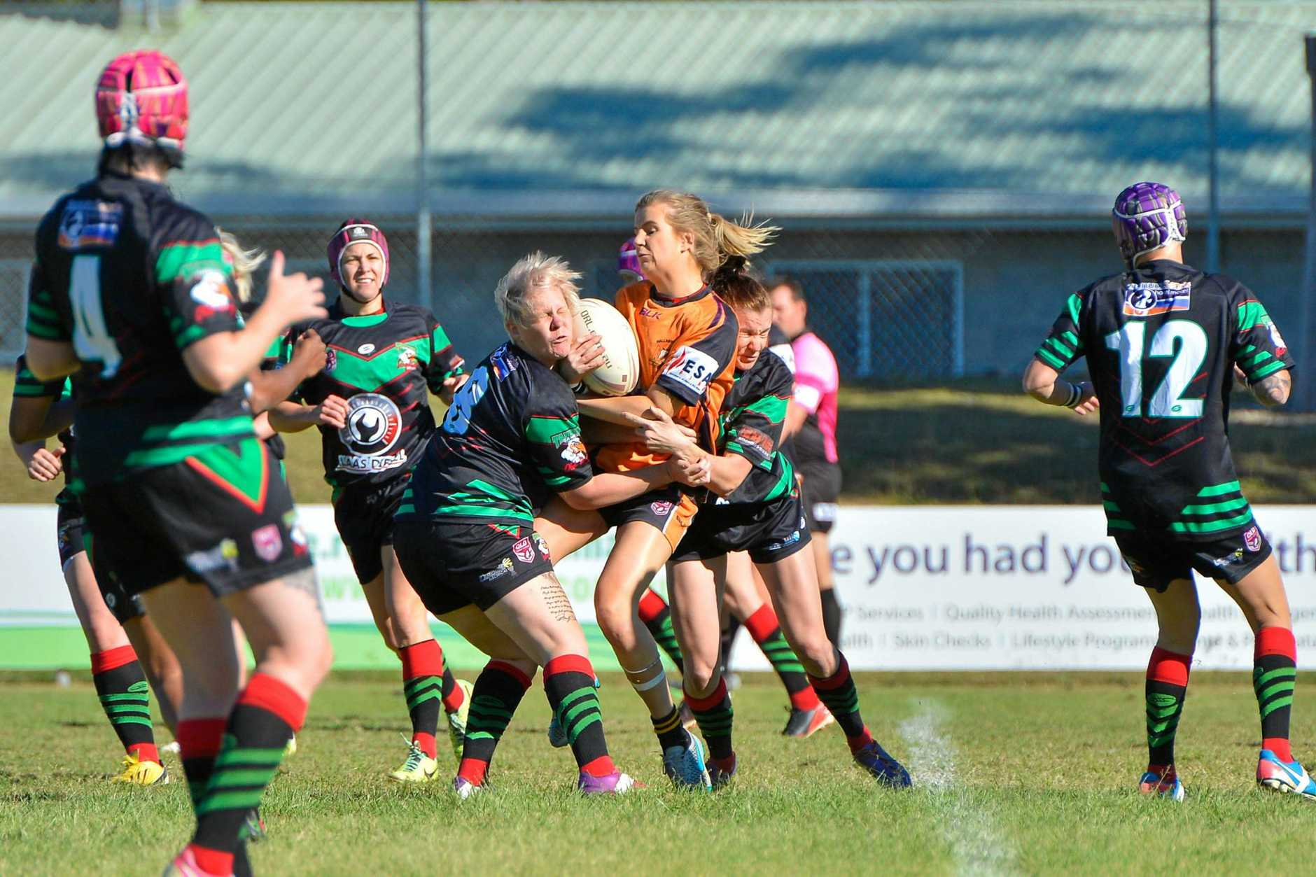 SHOWDOWN: Tannum Seagals' Nadine Day puts in a hard tackle in last year's preliminary final against Wallabys.