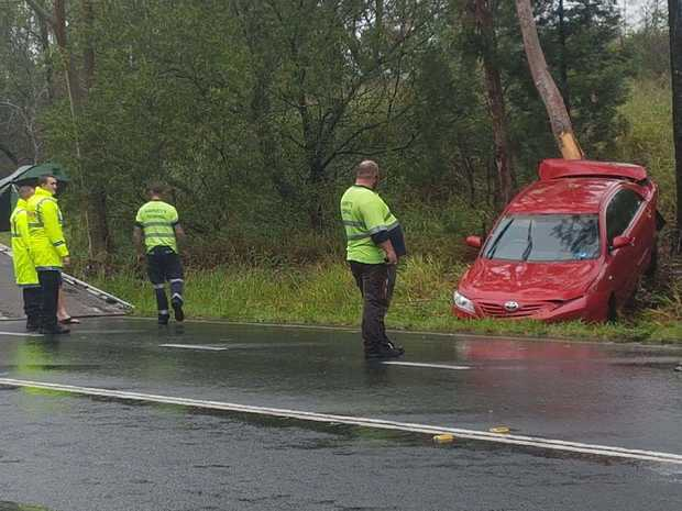 Clean up crews at the scene of a two-vehicle crash on the Cunningham Highway on Tuesday morning.