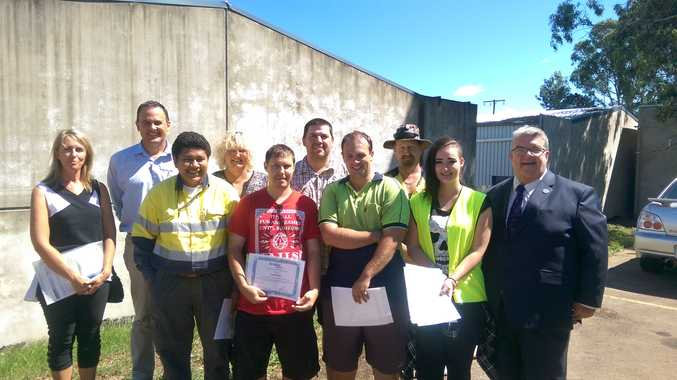 (BacK from left) Belinda Paul from Youth Development & Training, Scott Christ from Dept of Education & Training, Brandi Lang, Josh Newsham, Michael Johnson, (front from left) Eva Paterson, David Went, Chris Devonshire, Mary Rollason and Lifeline Darling Downs & South West Qld CEO Derek Tuffield.