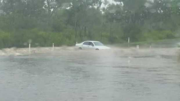 Emergency services rescued a man after his vehicle was washed into floodwaters this morning.