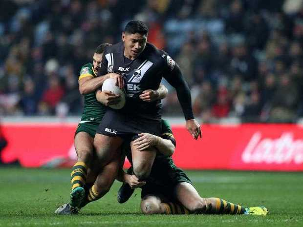 New Zealand's Jason Taumalolo is brought down by the Australian defence during the Four Nations rugby league match in November 2016