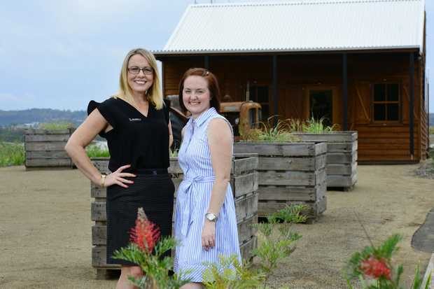 Sales consultant Rachel Hargreaves (left) of Oliver Hume Waterlea at Wallon with new land owner Rebecca Mallett.