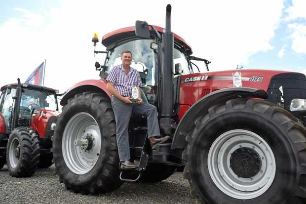 FAMILY BUSINESS: McDonald Murphy Machinery Bundaberg managing co-director  Ross Cheshire with his two IH Case Farmall Sales Achievement awards.