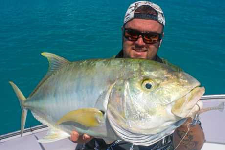Mathew McKay with  a golden trevally.